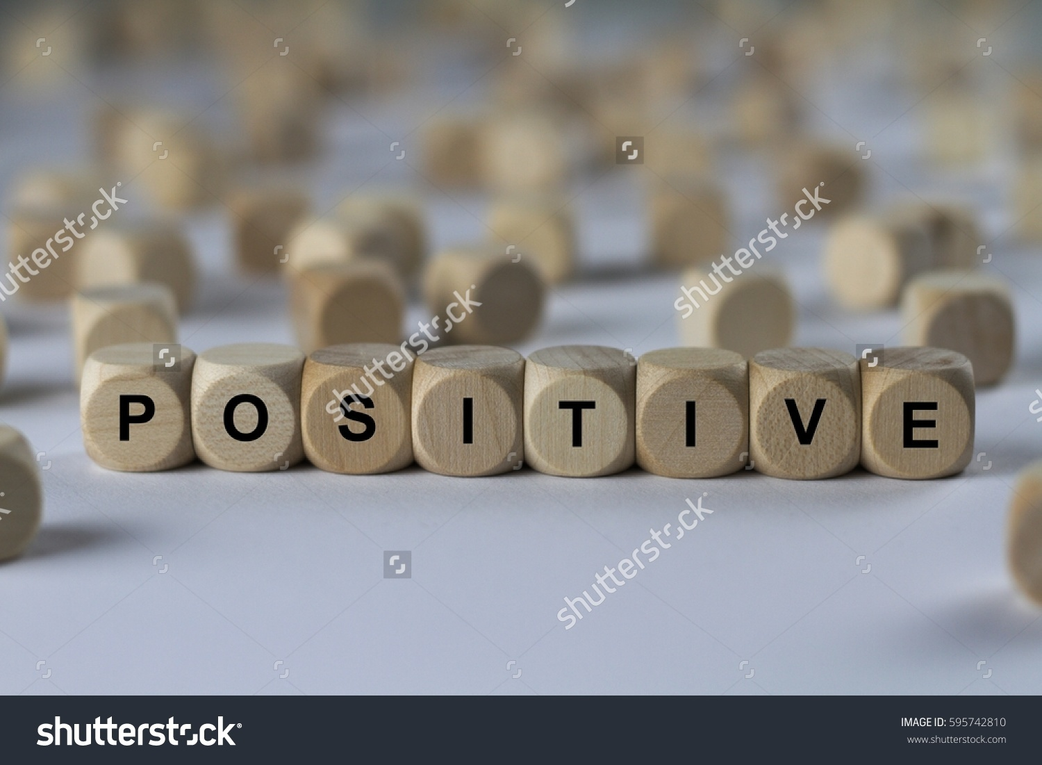 Stock Photo Positive Cube With Letters Sign With Wooden